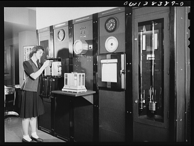 Washington, D.C. The U.S. Weather Bureau station at the National Airport. Surface weather being observed at a Weather Bureau instrument panel on which are mounted barometers, thermometers, wind direction and velocity indicators, and other instruments for measuring weather elements