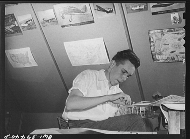 Washington, D.C. Walter Spangenberg, a student at Woodrow Wilson High School, has fitted up a workshop in the attic of his home where he builds model airplanes, ships, and trains