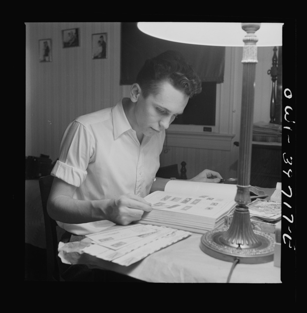 Washington, D.C. Walter Spangenberg, a student at Woodrow Wilson High School, working on his stamp collection