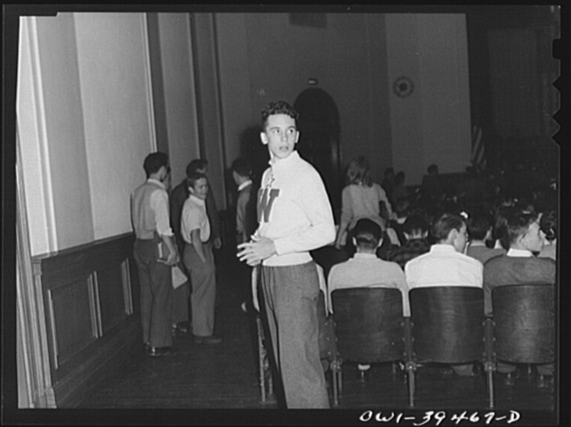 Washington, D.C. Walter Spangenberg acting as usher at a student assembly at Woodrow Wilson High School