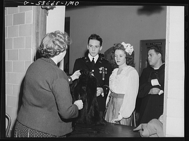 Washington, D.C. Walter Spangenberg and his date at the check room at the regimental ball at Woodrow Wilson High School