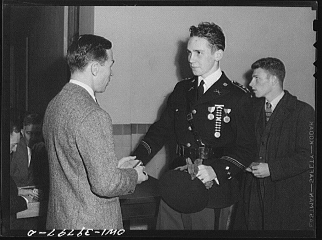 Washington, D.C. Walter Spangenberg having his hand stamped for identification as he enters the door at the regimental ball at Woodrow Wilson High School