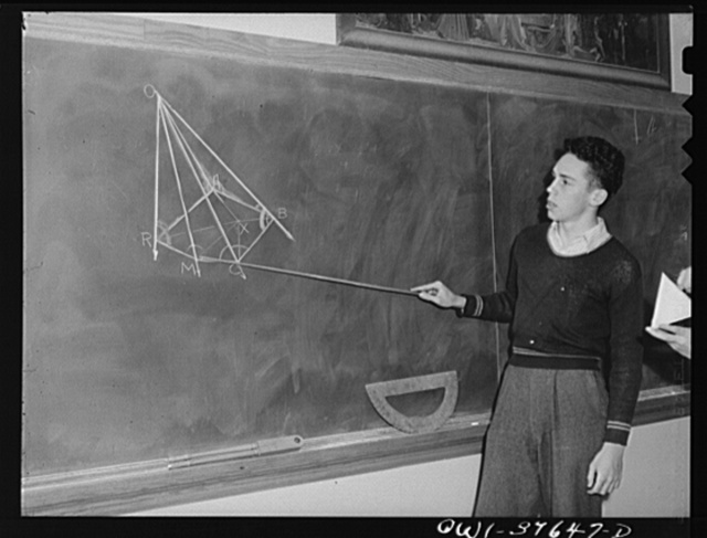 Washington, D.C. Walter Spangenberg (holding the pointer) giving a demonstration in geometry class at Woodrow Wilson High School