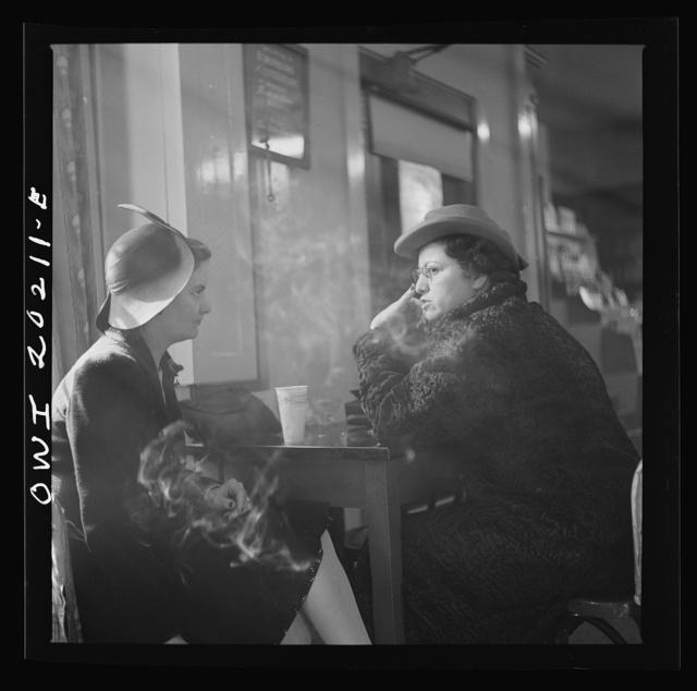 Washington, D.C. Women gossiping in a drugstore over cokes