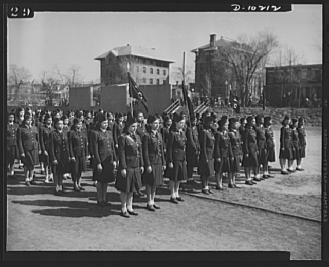 Washington public schools go to war. The public schools of Washington, D.C., like those in most other sections of the country, have revised their curricula to fit the pupils for fuller participation in the war effort. They have gone all-out for the Program of Civilian Defense which includes military drill for both high school boys and girls as part of the physical fitness course