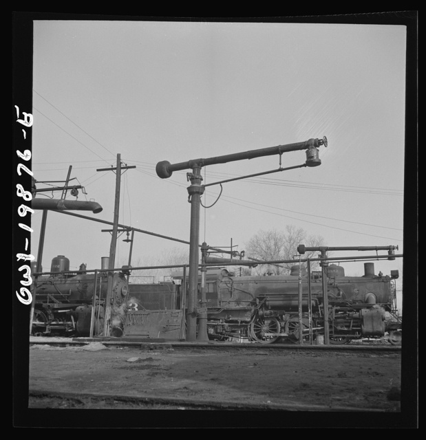 Waynoka, Oklahoma. Oil and water derricks at the roundhouse between Kansas City, Missouri and Clovis, New Mexico. The Atchison, Topeka, and Santa Fe Railroad engines use oil for fuel
