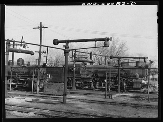 Waynoka, Oklahoma. Oil and water derricks near the Atchison, Topeka and Santa Fe Railroad roundhouse