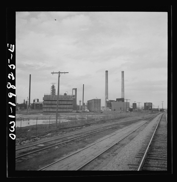 Wellington, Kansas. Passing an oil refinery on the Atchison, Topeka, and Santa Fe Railroad between Emporia and Wellington, Kansas