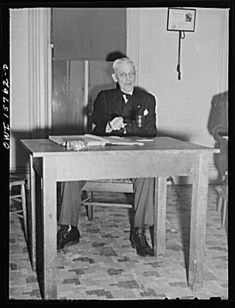 West Chicago, Illinois. Mr. W.M. Hoag, president, opens the meeting of the west Chicago Lodge of the International Brotherhood of Railway Trainmen (Northwestern Railroad local)
