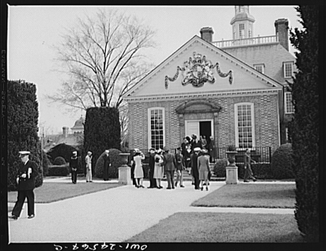 Willamsburg, Virginia. The capitol of the Virginia colony during the eighteenth century which was reconstructed and restored to its original state by John D. Rockefeller, Jr. during the 1930s. Coat of arms of George I of England above the ballroom wing of the governor's palace