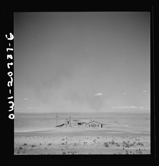 Willard, New Mexico. Passing a filling station in the desert country along the Atchison, Topeka and Santa Fe Railroad between Vaughn and Belen, New Mexico
