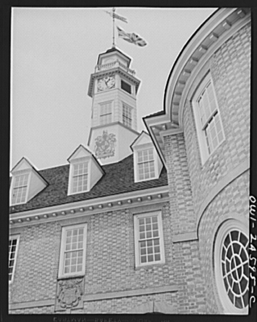 Williamsburg, Virginia. The capitol of the Virginia colony during the eighteenth century which was reconstructed and restored to its original state by John D. Rockefeller, Jr. during the 1930s. Capitol building with an early English flag and coat of arms