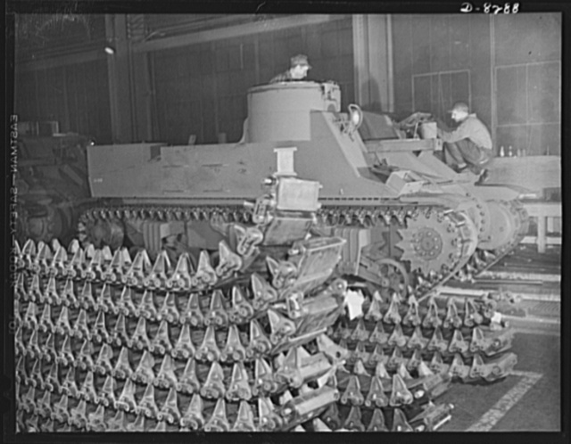 Winner of the plant award. New M-7 mobile howitzer carriages roll down the production lines of the American Locomotive Company in Schenectady, New York. These fast, easily maneuvered cannon carriers are typical of the new mechanized equipment being provided to American troops