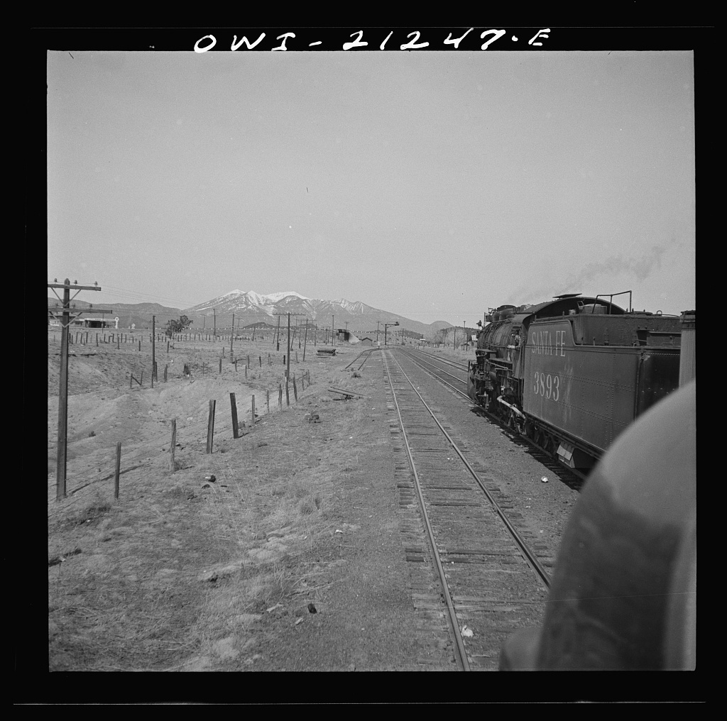 Winona, Arizona. Passing another freight train in a siding along the Atchison, Topeka and Santa Fe Railroad between Winslow and Seligman, Arizona