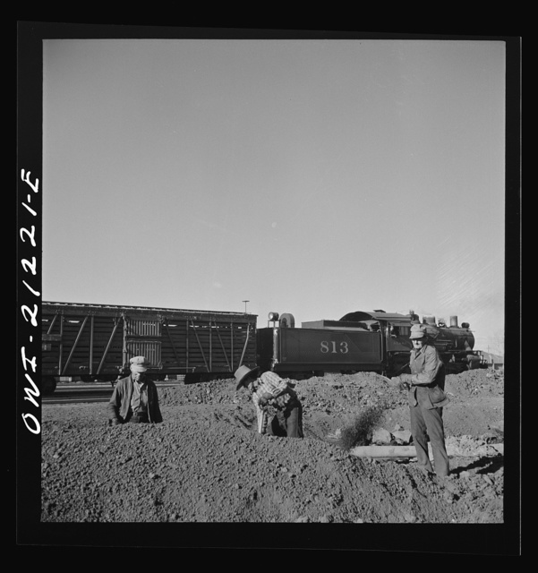 Winslow, Arizona. Indian laborers at work in the Atchison, Topeka and Santa Fe Railroad yard