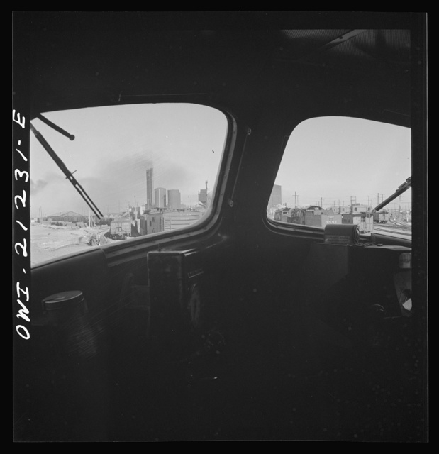 Winslow, Arizona. Looking through the windshield of a diesel freight engine pulling out of the Atchison, Topeka and Santa Fe Railroad yard