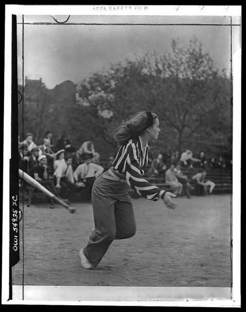 [Woman playing softball with other members of Othello production, Central Park, New York City]