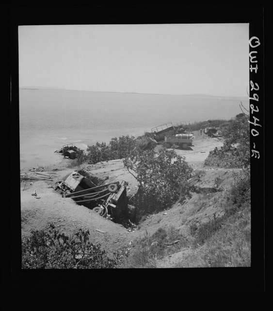 Wreckage of German military equipment at Porto Farina, a fishing village between Bizerta and Tunis, where the German Tenth and Fifteenth Panzer Divisions attempted an evacuation