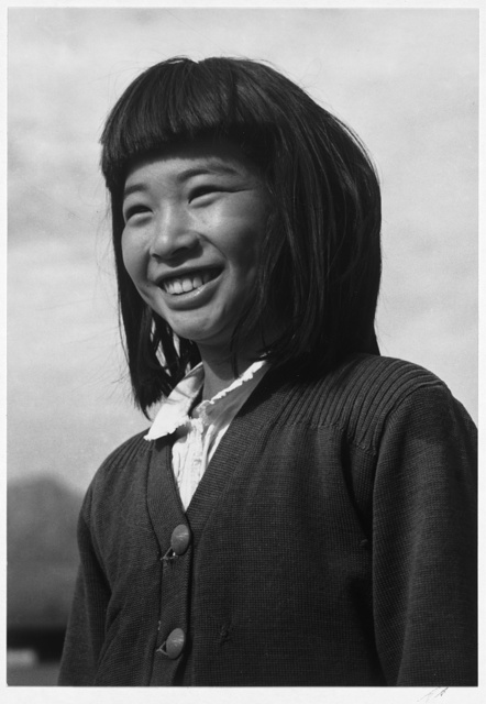 Young girl smiling (Oriental type) / photograph by Ansel Adams.