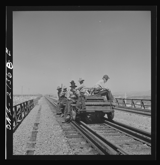 Yucca, Arizona. A section crew returning from work on the Atchison, Topeka and Santa Fe Railroad between Seligman, Arizona and Needles, California