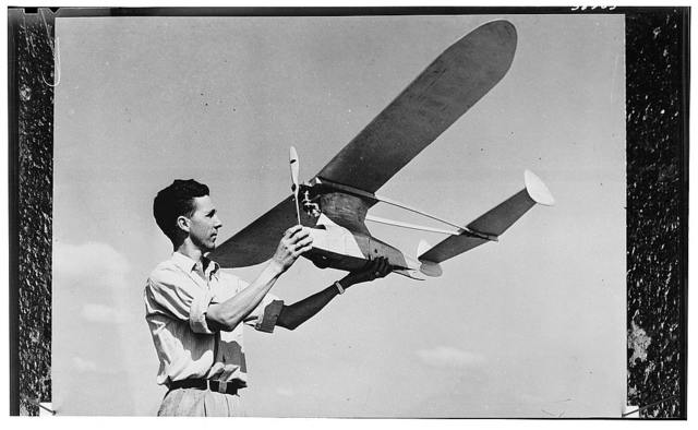 America's youth builds and flies model planes on miniature flying fields. A member of the San Antonio Gas Model Club, which does its weekly flying at Kelly Field in the city of San Antonio in the southwestern U.S. state of Texas, proudly displays his amphibian model airplane, which has a six foot (1.8 meters) wing spread. When an earlier model crashed there was nothing left but one good wing. This young model enthusiast decided to build a new plane around it. He built an amphibian and turned out a perfect flying job. The plane is made of balsa wood covered with silk and waterproofing material. Like millions of other young Americans who make model building their hobby, this young man will be called upon to put his practical experience in aeronautics to use in the air-minded post war world