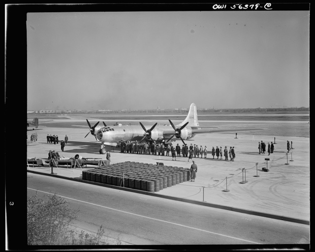 B-29 Super Fortress on display at Washington National Airport. Note fuel tanks in foreground which is necessary to fill fuel tanks--equivalent to railroad tank car