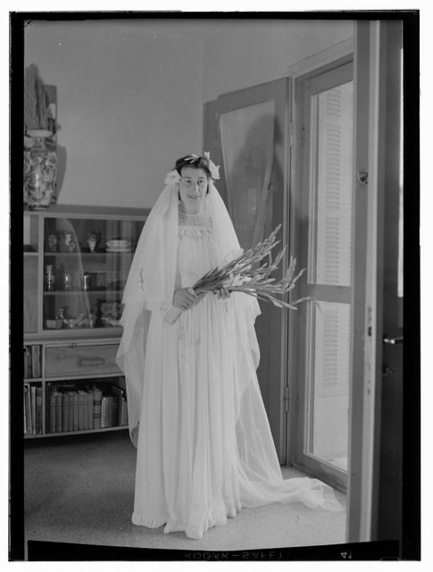 [Bride in bridal gown holding flowers, Dawkins Anderson wedding]