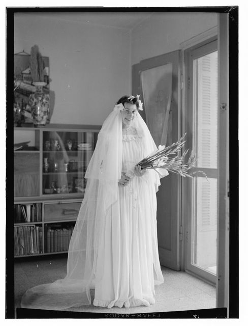 [Bride in gown holding flowers, Dawkins Anderson wedding]