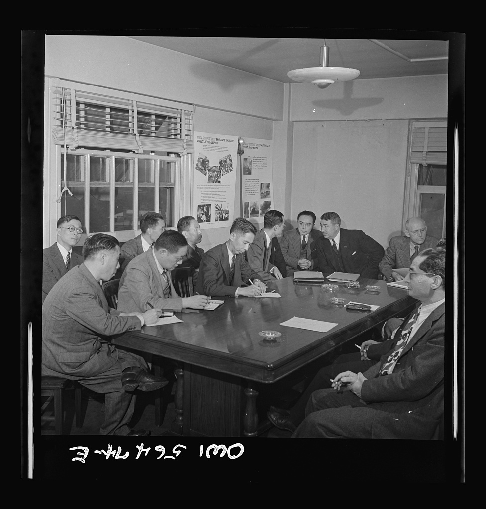 Chinese technical experts in Washington in connection with the UNRRA (United Nations Relief and Rehabilitation Administration) training program at a conference with C.L. Moffatt (at extreme right, dark suit, handkerchief in breast pocket) , discuss flood control as a problem of industrial rehabilitation