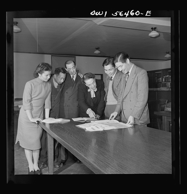 Chinese technical experts inspect reference material in University of Maryland library where they are attending UNRRA (United Nations Relief and Rehabilitation Administration) training center. From left: Miss Ing (from Far Eastern Division, China branch, UNRRA Washington D.C. office); C.C. Chen, N.F. Chang, Miss Eleanor Hindler (special consultatnt, ILO office, Montreal, acting as coordinator of the course for Chinese technical experts at UNRRA training center); Chuan-Kwang Lin; W.T. Chang