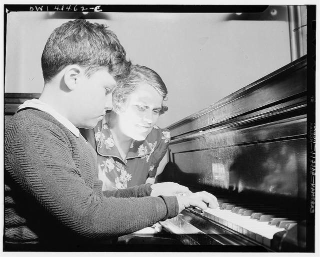 New York, New York. A blind youngster getting his weekly piano lesson at the Lighthouse, an institution for the blind, at 111 East Fifty-ninth Street