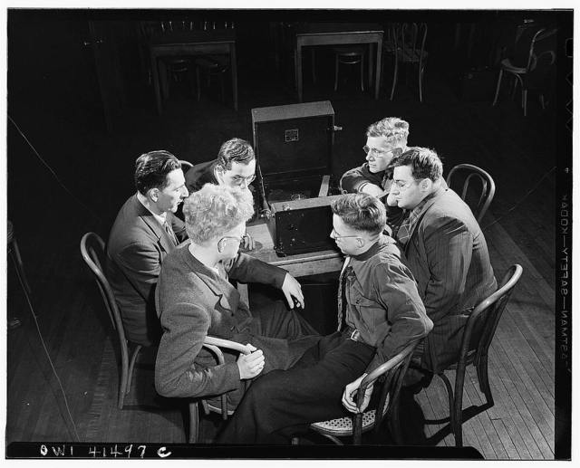 "New York, New York. Blind students listening to their lesson by the ""Talking Book""  at the Lighthouse, an institution for the blind, at 111 East Fifty-ninth Street"