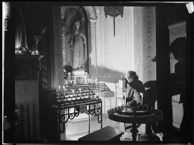 New York, New York. Noon mass at Saint Vincent de Paul's Church on D-day