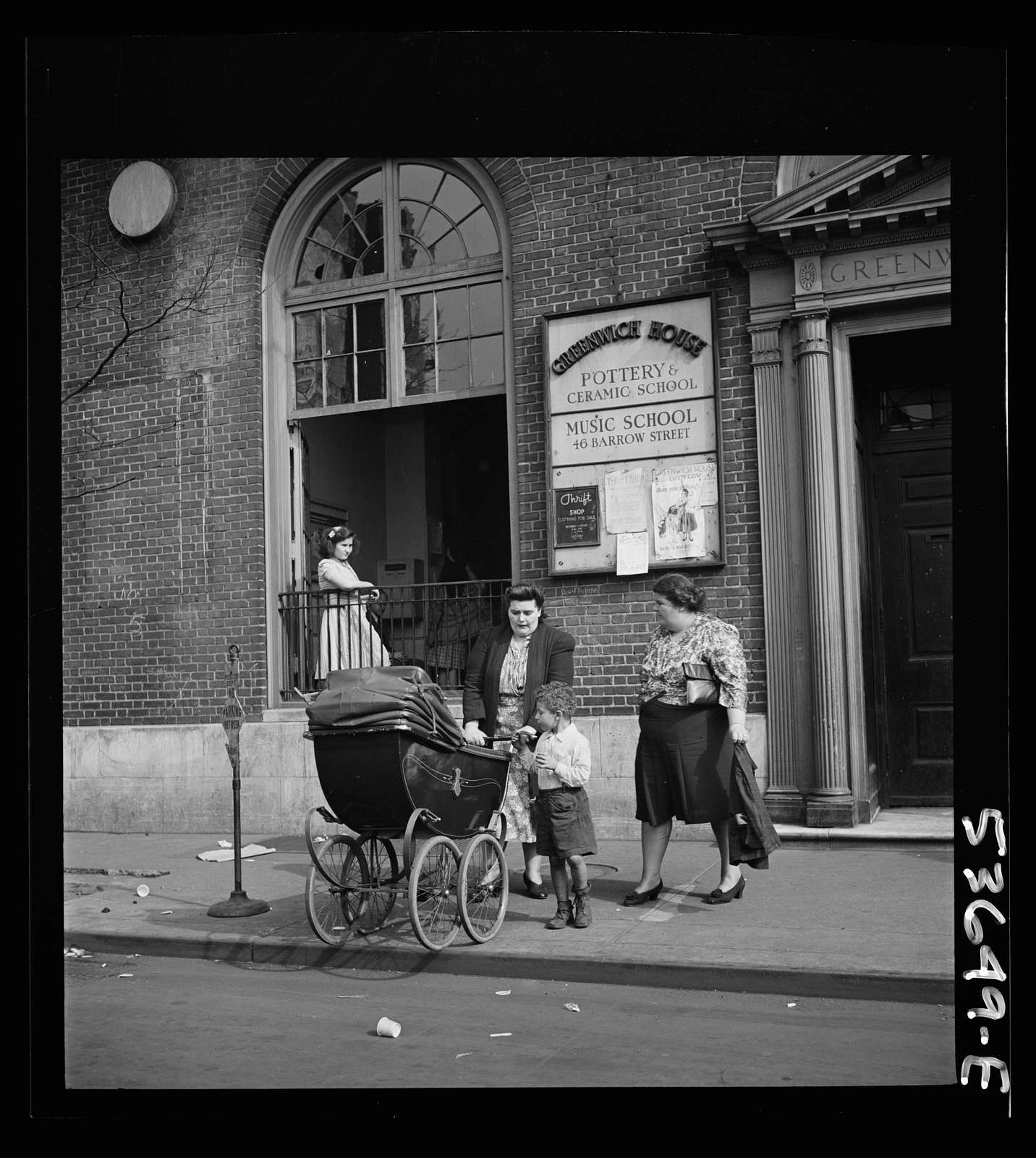 New York, New York. Two working mothers calling for children at Greenwich House, a neighborhood center, where they have left them early in the morning for day care