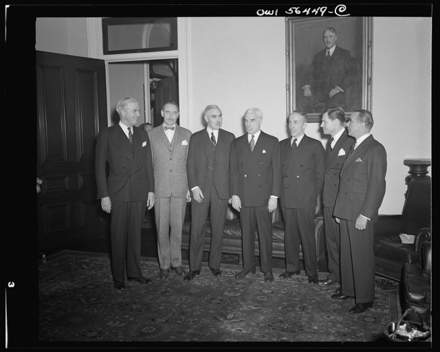 Secretary of State Edward Stettinius presenting new Under-Secretary of State Joseph C. Grew and five of the new assistant secretaries at the oath of office ceremonies. Left to right: William L. Clayton; Dean Acheson; Joseph C. Grew, Under-Secretary; Edward R. Stettinius, Secretary of State; Archibald MacLeish; Nelson A. Rockefeller; James C. Dunn