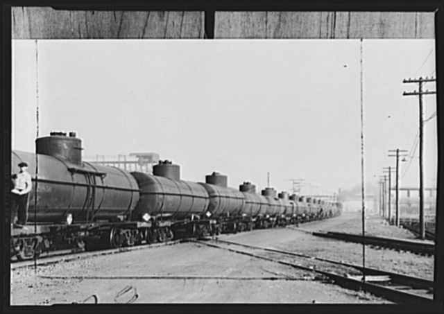 Tank cars, vital link in wartime domestic oil transport; with railroads breaking all-time traffic records, they are still able to give valuable service in hauling the tank cars of the oil companies from Gulf Coast and Texas fields. But only a fraction of the required tank cars are available. Railroads are hauling 500,000 barrels daily, hope for 800,000 as more cars can be made available for movement to the East. But this still would be only half of the normal civilian requirement