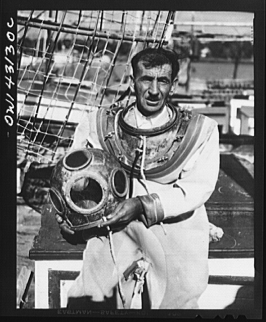 Tarpon Springs, Florida. A Greek-American deep sea fisherman with his diver's helmet