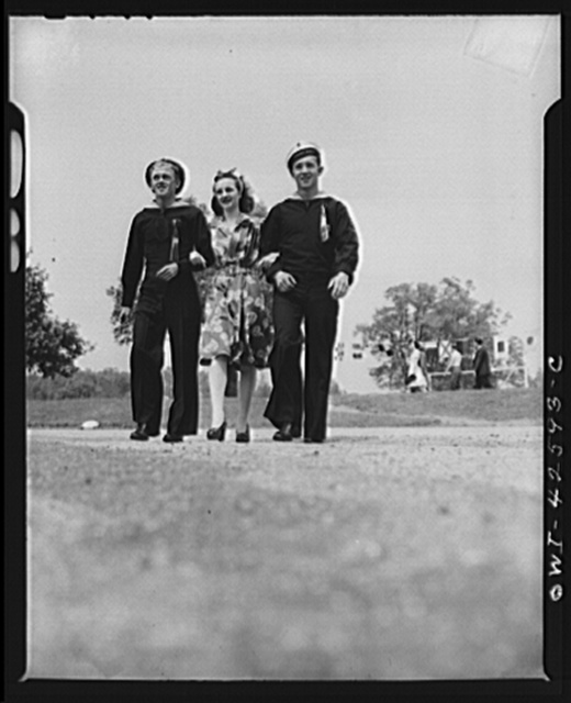 Travers Island, New York. Norwegian Independence Day celebration at the Norwegian gunners' school. Two Norwegian sailors taking a girl for a stroll