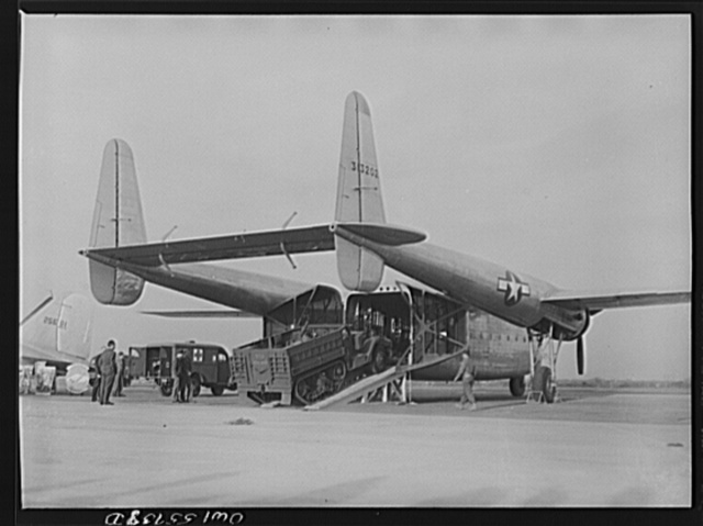Truck being loaded into the new C-82 at demonstration of equipment held by United States Army Air Forces. The after end of the fuselage opens to the complete height and width of the interior, which is square. This is first plane designed solely for hauling military cargo, and is the product of the combined engineering staffs of Air Technical Service Command and the Fairchild Aircraft Corporation