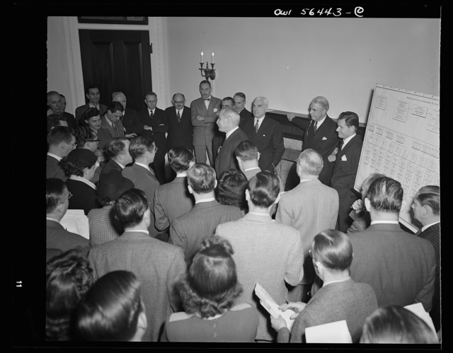 Under-Secretary of State Joseph C. Grew, after being introduced at press conference by Secretary of State Stettinius, addressing newsmen
