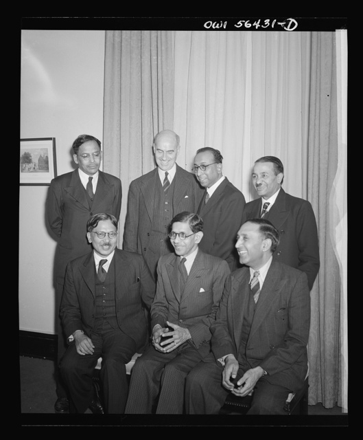 Washington, D.C. A group of leading Indian scientists who arrived in the United States on Dec. 8, 1944, for an eight weeks tour of the country. They had just completed a tour of England and were anxious to meet leading United States scientists in the fields of physics and chemistry. Left to right seated: Sir Jnan C. Gsosh, Prof. J.N. Mukherjee, and Dr. N. Ahmad. Standing: Dr. M.N. Saha, Dr. F.S. Coan, United States State Department, Dr. S.K. Mitra and Sir S.S. Bhatnagar