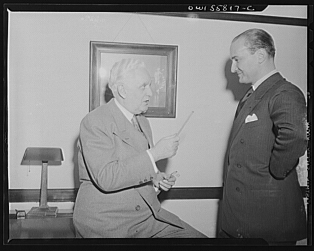 Washington, D.C. Mario Verdi (left), OWI (Office of War Information) radio commentator for Italy, visiting Mr. Leo Crowley, administrator of the Federal Economic Administration