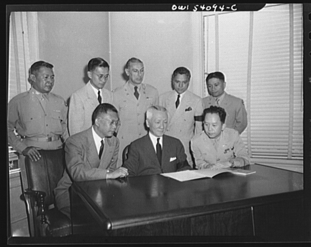 Washington, D.C. The new president of the Philippines shown with the new cabinet. Front row; left to right: Jaime Hernandez, Secretary of Finance; President Sergio Osmena; Colonel Carlos P. Romulo, Resident Commissioner and Secretary of Information. Back row, left to right: Colonel Mariano A. Erana, Judge Advocate General of the Army of the Philippines in charge of the Department of Justice, Labor, and Welfare; Dr. Arturo B. Rotor, Secretary of Agriculture and Commerce; Ismael Mathay, Budget and Finance Commissioner; Colonel Alejandro Melchor, Under Secretary of National Defense representing General Basilio Valdesm the Secretary of National Defense