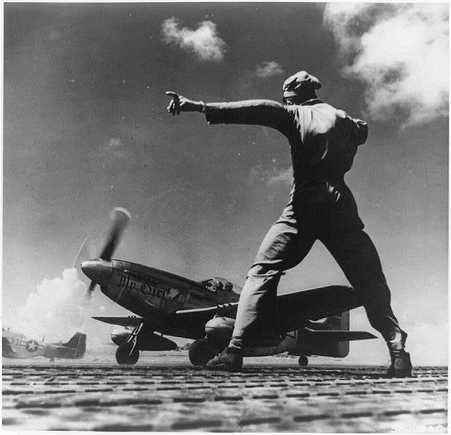 "A North American P-51 nicknamed ""My Girl"" takes off from Iwo Jima, in the Bonin Islands"
