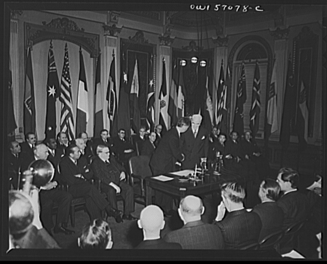 Ambassador Henri Bonnet and Secretary of State Stettinius shake hands upon the occasion of the signing of the United Nations declaration by France