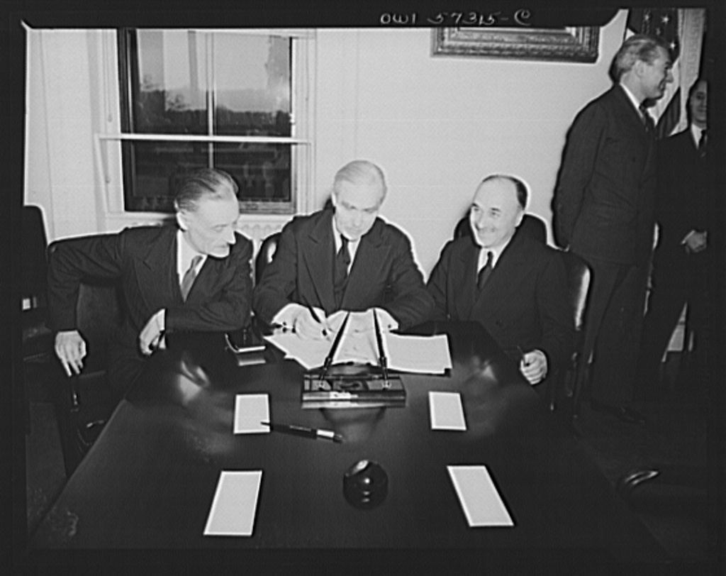French conclude agreement on lend-lease and reverse lend-lease. Undersecretary of State Joseph C. Grew signs French lend-lease and reverse lend-lease.  Left to right: Henri Bonnet, French Ambassador, Joseph C. Grew, Undersecretary of State and Jean Monnet