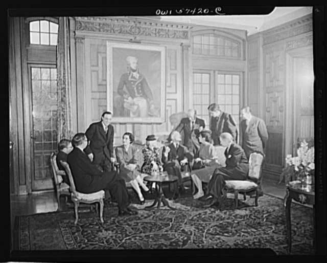 French journalists chat with Ambassador Bonnet after a luncheon at the French Embassy. Seated left to right: Pierre Denoyer, Jean-Paul Sartre, Stephane Pizella, Mme. Bonnet, Mme. Andree Viollis, Ambassador Bonnet, Mme. Etiennette Benichon, Francois Prieur. Standing: Louis Lombard, Robert Villers and Henri Villieras de Longfies, Assistant to Press Attache of French Embassy