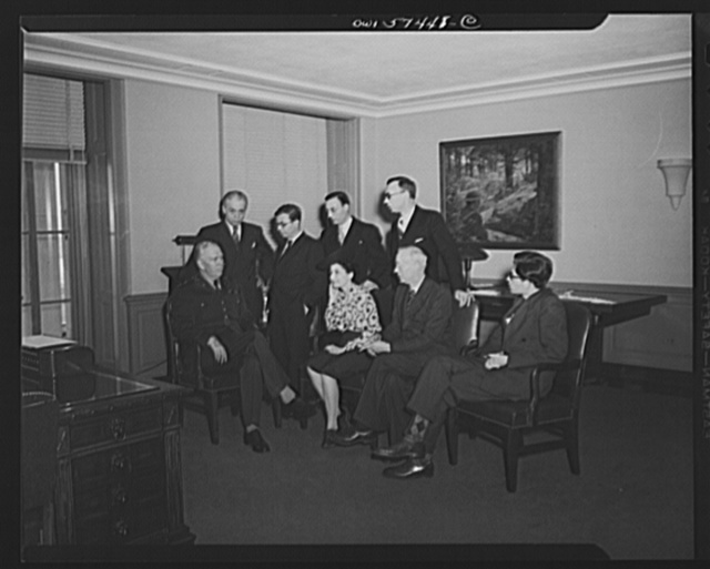 French journalists visit General George C. Marshall at his office in the Pentagon building. Left to right: (seated), General Marshall, Mme Etiennette Benichon, Louis Lombard, (standing) Francois Prieur, Jean-Paul Sartre, Stephane Pizella, and Pierre Denoyer