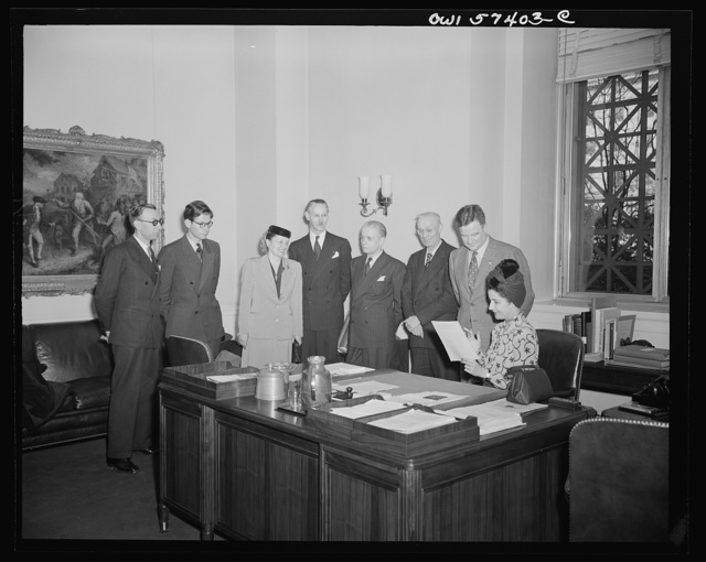 French journalists visit the National Gallery of Art, Washington, D.C. March 4, 1945. Shown in Mr. MacGill James' office. Mr. James is assistant director of the Gallery. Left to right: Pierre Denoyer, Fobert Villers, Mme. Rene Batigne, M. Rene Batigne, Francois Prieur, Louis Lombard, Mr. James, and Mme. Etiennette Benichon