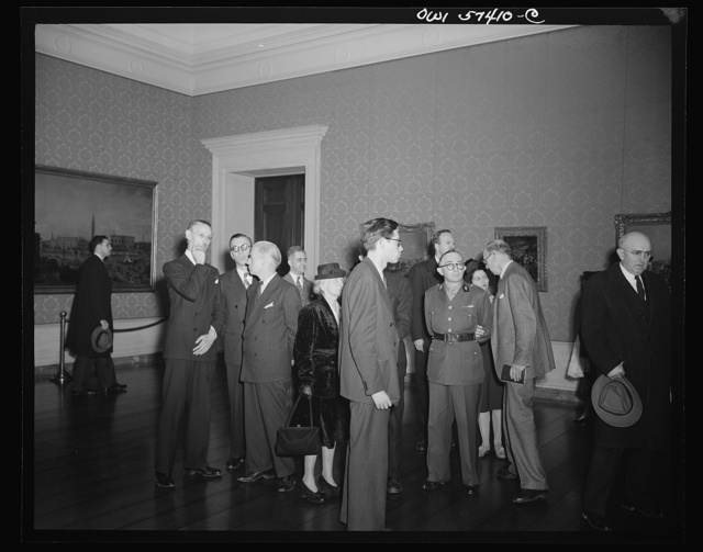 French journalists visit the National Gallery of Art, Washington, D.C., March 4, 1945, where they are  shown around by Rene Batigne, Curator of the French Section of the Gallery. Left to right: M. Batigne, Pierre Denoyer, Francois Prieur, Frederick Paul Farish of the OWI French Desk, Mme. Andree Viollis, Robert Villers, B.H. Underhill of the Office of War Information, Commander Pages of the French Military Mission in Washington, and Mme. Etiennette Benichon